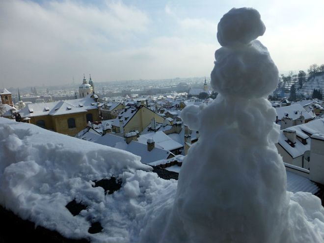 Snow man looking enjoying his view in Prague